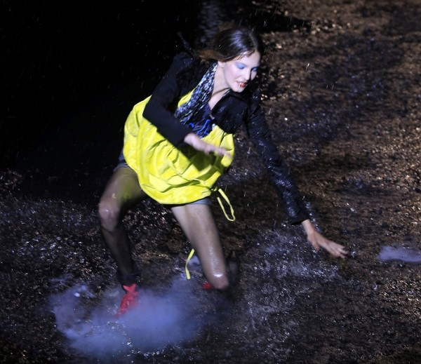 A model falls down while she presents a creation from Cavalera's collection during Sao Paulo Fashion Week Winter 2011 in Sao Paulo, February 2, 2011.