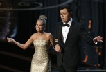 Kristin Chenoweth and Oscars host Seth MacFarlane perform the closing number at the 85th Academy Awards in Hollywood, California, February 24, 2013. 