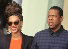 U.S. singer Beyonce (L) and her husband rapper Jay-Z walk as they leave their hotel in Havana April 4, 2013. 