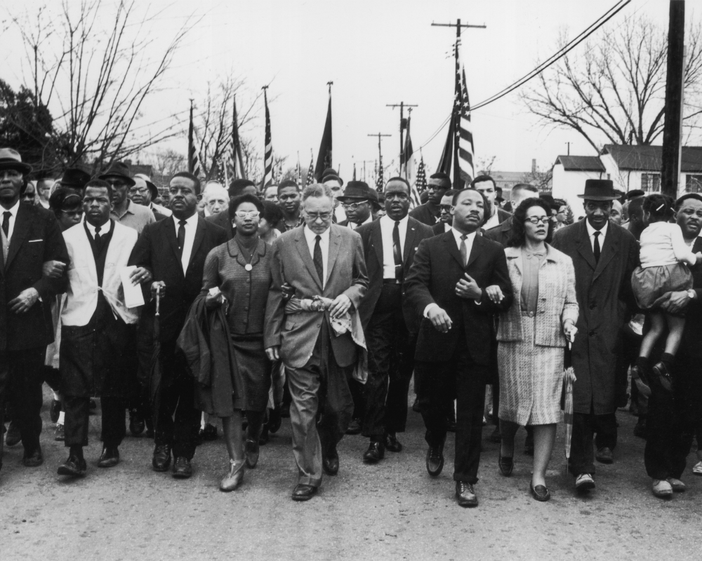 Martin Luther King, Jr., Coretta Scott King and more march to Montgomery, Ala. Photo Credit William Lovelace/Express/Getty Images