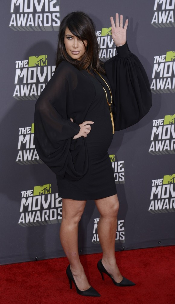 Socialite Kim Kardashian arrives at the 2013 MTV Movie Awards in Culver City, California April 14, 2013.