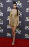 Singer Selena Gomez arrives at the 2013 MTV Movie Awards in Culver City, California April 14, 2013.