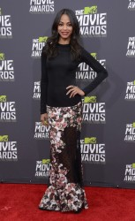 Actress Zoe Saldana arrives at the 2013 MTV Movie Awards in Culver City, California April 14, 2013.