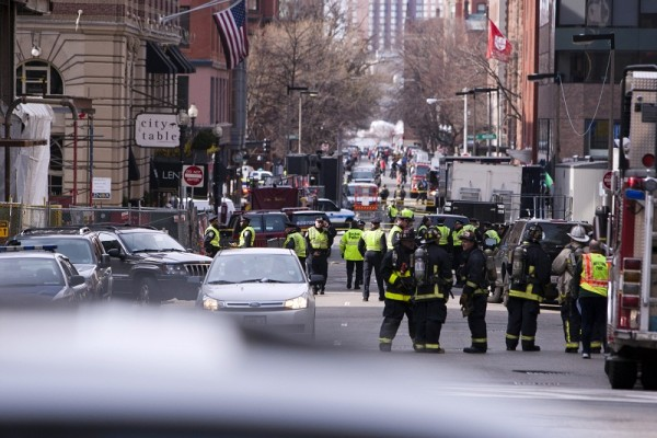 Boston Police and Firemen stand by at the scene after explosions reportedly interrupted the running of the 117th Boston Marathon in Boston, Massachusetts April 15, 2013. Two explosions hit the Boston