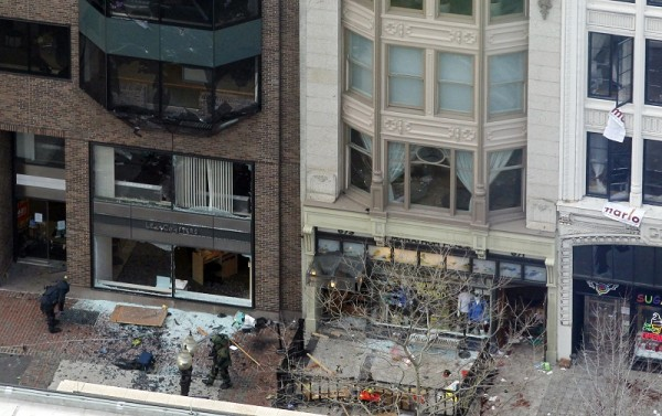 Men in bomb-disposal suits investigate the site of an explosion which went off on Boylston Street during the 117th Boston Marathon in Boston, Massachusetts April 15, 2013. Two explosions hit the Bosto
