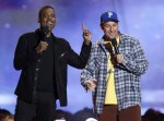 Chris Rock (L) and Adam Sandler present an award for best wtf moment at the 2013 MTV Movie Awards in Culver City, California April 14, 2013.
