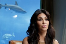TV personality and actress Kim Kardashian speaks during an interview with Reuters in Dubai October 13, 2011.