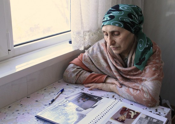 Patimat Suleimanova, aunt of Boston bombing suspects Dzhokhar and Tamerlan Tsarnaev, looks at photos from a family album at her house in Makhachkala, April 22, 2013. Dzhokhar Tsarnaev, 19, an ethnic C
