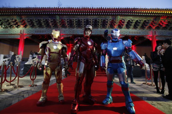 "Performers dressed as Iron Man pose for a photo during a promotional event of the movie ""Iron Man 3"" before its release in China in early May at the Imperial Ancestral Temple of Beijing's Forbidden Ci"