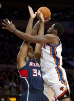 Jason Collins (#34) blocks a shot by New York Knicks guard Bill Walker