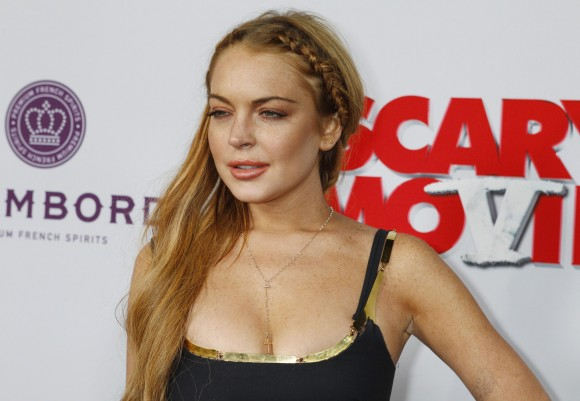 """Actress Lindsay Lohan arrives at the premiere of the film """"Scary Movie 5"""" in Hollywood April 11, 2013."""
