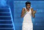 "Canadian singer Justin Bieber performs on stage during a concert as part of his ""Believe"" World Tour at the Sevens Stadium in Dubai May 4, 2013."