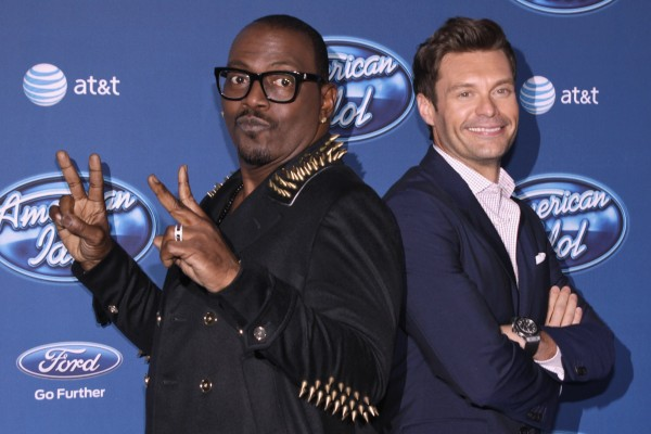 Musician and producer Randy Jackson (L) and TV and radio personality Ryan Seacrest arrive for the American Idol Season 12 premiere event at Royce Hall at University of California Los Angeles, in Los A