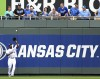 Kansas City Royals center fielder Lorenzo Cain catches a pop fly by Minnesota Twins Justin Morneau in the fourth inning of the Royals' home opener MLB American League baseball game in Kansas City, Mis
