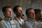 Members of America&#039;s Cup challenger team Luna Rossa Challenge listen as team owner Patrizio Bertelli speaks at a news conference at the team&#039;s base in Alameda, California May 17, 2013. 