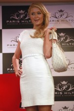 U.S. socialite Paris Hilton poses before a news conference during the launch of her latest store in Bogota, April 24, 2013.