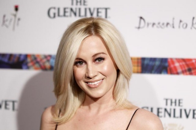 "Singer Kellie Pickler arrives at the 2011 ""Dressed to Kilt"" charity fashion show in New York April 5, 2011."
