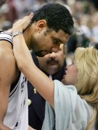 San Antonio Spurs' Tim Duncan hugs his wife Amy after the Spurs defeated the Detroit Pistons in the 2005 NBA Finals in San Antonio. San Antonio Spurs Tim Duncan (L) hugs his wife Amy after the Spurs d