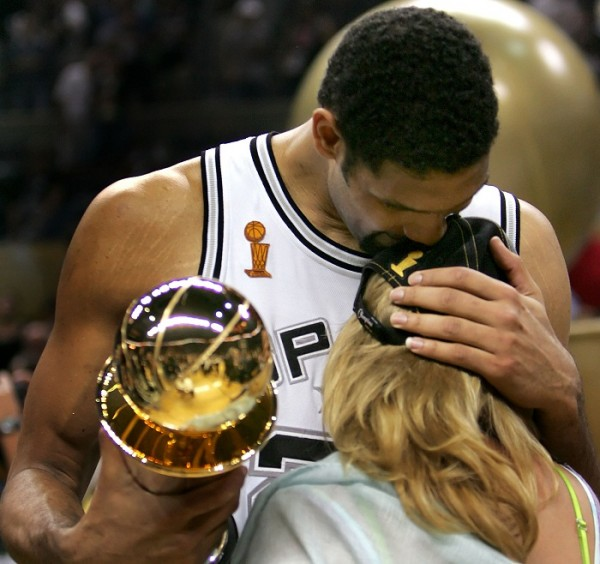 San Antonio Spurs Tim Duncan kisses his wife Amy after Spurs defeated Detroit Pistons in Game 7 to win 2005 NBA Championship. San Antonio Spurs Tim Duncan (L) kisses his wife Amy after the Spurs defea