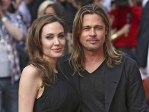 Angelina Jolie poses with her fiance Brad Pitt as they arrive for the world premiere of his film World War Z in London June 2, 2013.