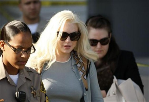 Actress Lindsay Lohan leaves the court after a progress report hearing in Los Angeles, California January 17, 2012.