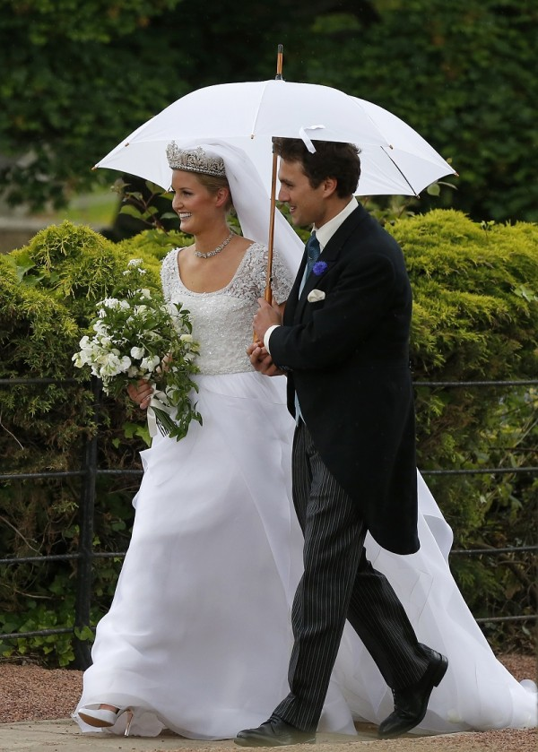 Thomas van Straubenzee and his new wife Melissa Percy, daughter of Ralph and Jane Percy, the Duke and Duchess of Northumberland, leave following their wedding at St Michael's Church in Alnwick, northe