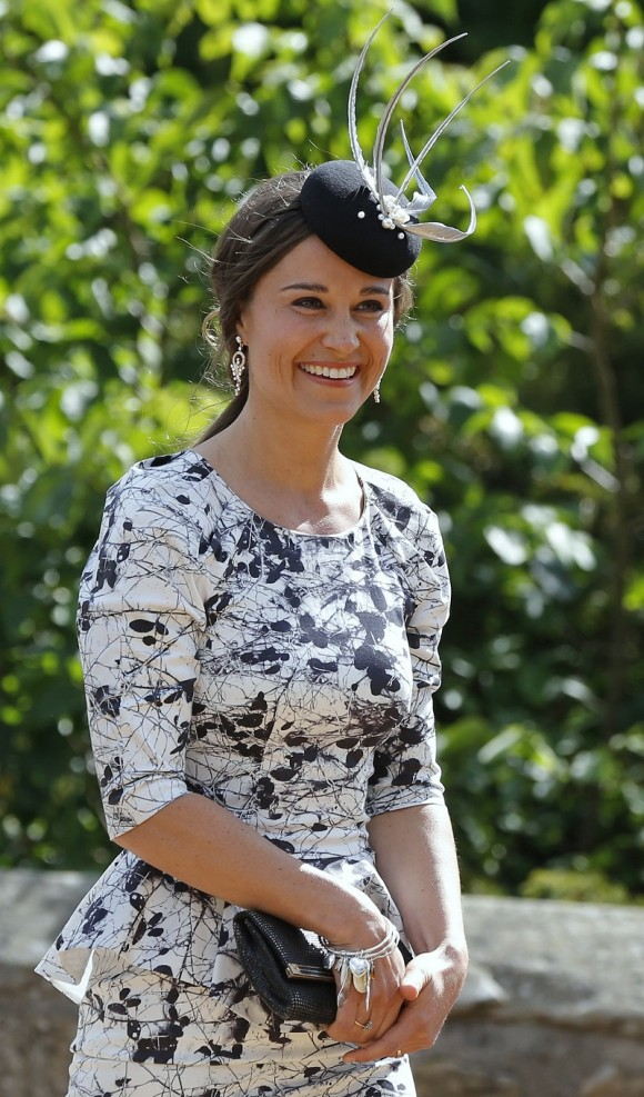 Pippa Middleton, the sister of Catherine, Duchess of Cambridge smiles as she arrives for the wedding of Thomas van Straubenzee and Melissa Percy, daughter of Ralph and Jane Percy, the Duke and Duchess