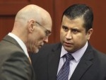 George Zimmerman talks to defense counsel Don West after the jury leaves the courtroom for more deliberations in Sanford, Florida July 13, 2013 during the trial of George Zimmerman in the shooting dea