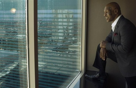 Photo Credit: Reuters/Steve Marcus - Former undisputed heavyweight champion Mike Tyson looks out the window of a guest room at the MGM Grand Hotel and Casino in Las Vegas, Nevada March 23, 2012.