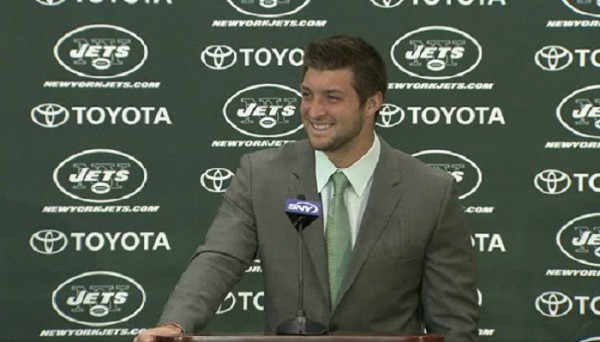 Photo Credit: NewYorkJets.com Screenshot - Tim Tebow smiles as he takes questions from reporters at the New York Jets New Jersey training facility on March 26, 2012.