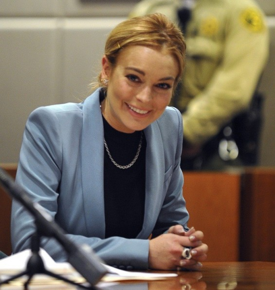 Photo Credit: Joe Klamar/Reuters - Actress Lindsay Lohan smiles during a progress report hearing in her DUI case at Airport Branch Courthouse in Los Angeles, California, March 29, 2012.