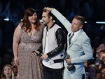 "Macklemore (R) & Ryan Lewis accept the award for best music video with a social message for ""Same Love,"" featuring Mary Lambert (L), during the 2013 MTV Video Music Awards in New York August 25, 2013."