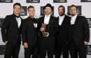 Justin Timberlake poses with his Michael Jackson Video Vanguard Award, with his old band 'N Sync during the 2013 MTV Video Music Awards in New York August 25, 2013. L-R are: JC Chasez, Lance Bass, Tim