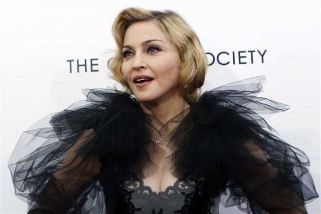 "Photo: Mike Segar/Segar - Madonna poses for photographers as she arrives for the premiere of the film ""W.E."" which she directed, at the Ziegfeld Theater in New York City, January 23, 2012."