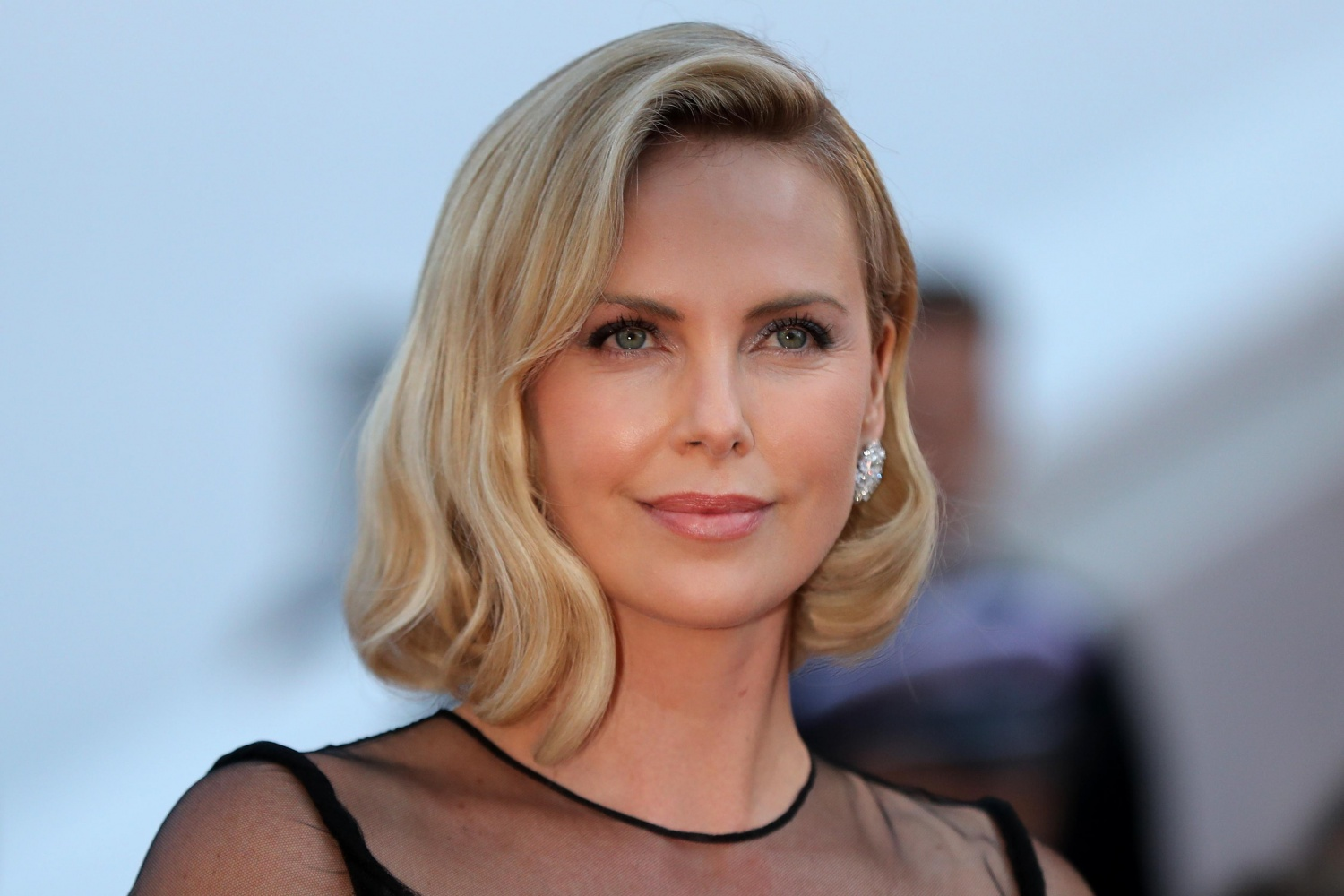 Charlize Theron, raised during apartheid, fears for her black children in America