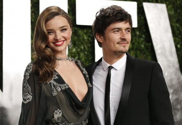 Orlando Bloom (R) and Miranda Kerr at the 2013 Vanity Fair Oscars Party in West Hollywood, California February 24, 2013.