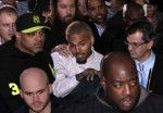 Rapper Chris Brown (C) leaves the U.S. District Court in Washington October 28, 2013.