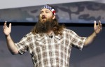 "Willie Robertson of the reality television show ""Duck Dynasty"" speak at the Wal-Mart Stores, Inc. U.S. Associates meeting in Fayetteville, Arkansas June 5, 2013."