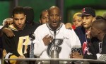 Rapper DMX (C) offers a prayer after winning the R&B Albums Artist of the Year award at the Billboard Music Awards show at the MGM Grand Hotel in Las Vegas December 8.