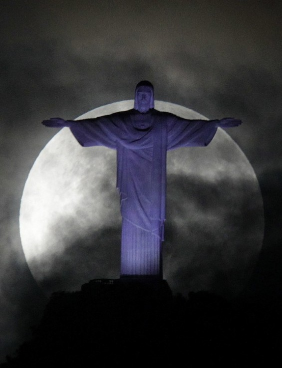 "The full ""super Moon"" is pictured over the Christ the Redeemer statue in Rio de Janeiro"