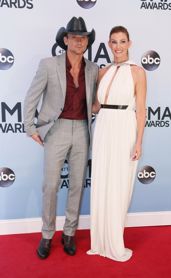Singers Tim McGraw and Faith Hill arrive at the 47th Country Music Association Awards in Nashville, Tennessee November 6, 2013.