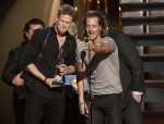 "Brian Kelley (L) and Tyler Hubbard (R) of Florida Georgia Line accept the award for single of the year for ""Cruise"" at the 47th Country Music Association Awards in Nashville, Tennessee November 6, 201"