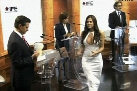 Handout still image taken from video shows former Playboy model and presidential debate assistant Orayen handing out cards to four candidates during a televised debate at the Federal Electoral Institute in Mexico City