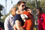 Actor Tom Cruise carries his daughter Suri into the Chelsea Piers sports facility in New York, July 17, 2012.
