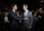"Cast member Chris Hemsworth (R) greets his brother actor Liam Hemsworth at the premiere of ""Thor: The Dark World"" at El Capitan theatre in Hollywood, California November 4, 2013. The movie opens in th"
