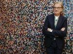 "Fashion designer Paul Smith poses after an interview with Reuters at the media launch of the exhibition ""Hello, My Name is Paul Smith"", at the Design Museum in London November 14, 2013."