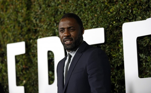 "Cast member Idris Elba poses at the premiere of ""Mandela: Long Walk to Freedom"" in Los Angeles, California November 11, 2013."