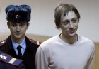 Former Bolshoi Theatre dancer Pavel Dmitrichenko (R) arrives for a court hearing in Moscow December 3, 2013.