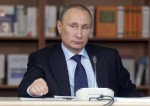 Russian President Vladimir Putin attends a meeting with academics at the Moscow State University December 3, 2013.