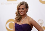 "Actress and singer Carrie Underwood from ABC's series ""Nashville"" arrives at the 65th Primetime Emmy Awards in Los Angeles in this September 22, 2013, file photo."